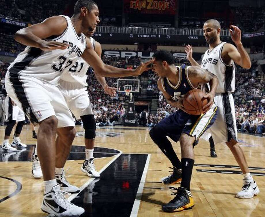 The Jazz's Devin Harris looks for room between the Spurs' Boris Diaw (left) and Tony Parker during first half action of Game 1 of the Western Conference first round Sunday April 29, 2012 at the AT&T Center. EDWARD A. ORNELAS/SAN ANTONIO EXPRESS-NEWS (EDWARD A. ORNELAS / SAN ANTONIO EXPRESS-NEWS)