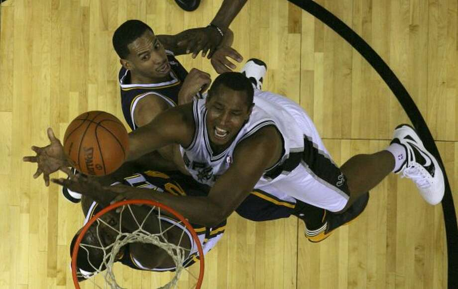 Spurs forward Boris Diaw goes for two against Utah Jazz C.J. Miles, under basket, and Devin Harrisduring game one of the Western Conference first round at the AT&T Center, Sunday, April 29, 2012. The Spurs won 106-91 to lead the series 1-0. Jerry Lara/San Antonio Express-News (Jerry Lara / San Antonio Express-News)