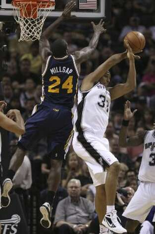 The Spurs' Boris Diaw keeps the ball away from Utah Jazz  Paul Milsap during the first half of game one of the Western Conference first round at the AT&T Center, Sunday, April 29, 2012. Jerry Lara/San Antonio Express-News (Jerry Lara / San Antonio Express-News)