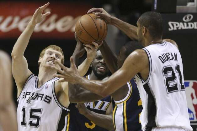 The Spurs' Matt Bonner and Tim Duncan put pressure on Utah Jazz Paul Milsap during the first half of game one of the Western Conference first round at the AT&T Center, Sunday, April 29, 2012. Jerry Lara/San Antonio Express-News (Jerry Lara / San Antonio Express-News)