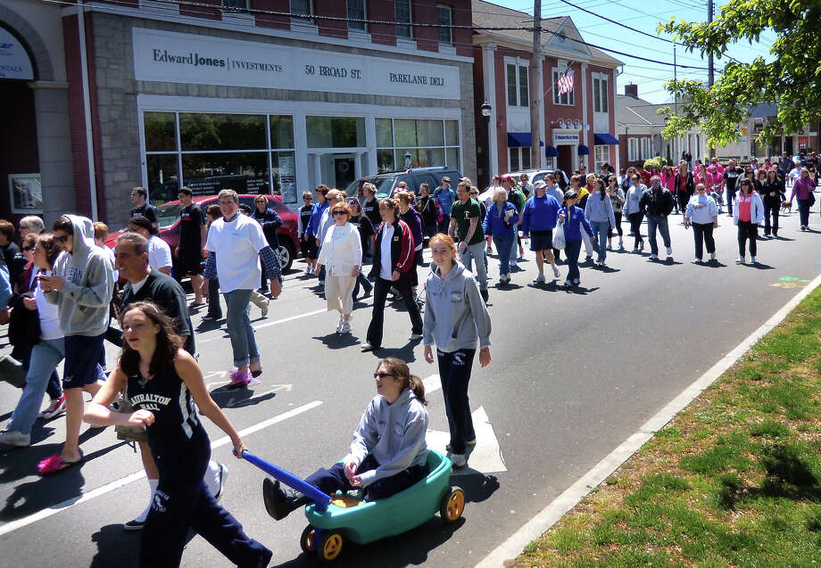John Burgeson/Staff photo  About 500 participated in the ìWalk a Mile in Her Shoesî fundraiser for the Rape Crisis Center of Milford, raising $17,000. The walk took supporters on a 45-minute stroll through downtown Milford. Photo: John Burgeson / Connecticut Post