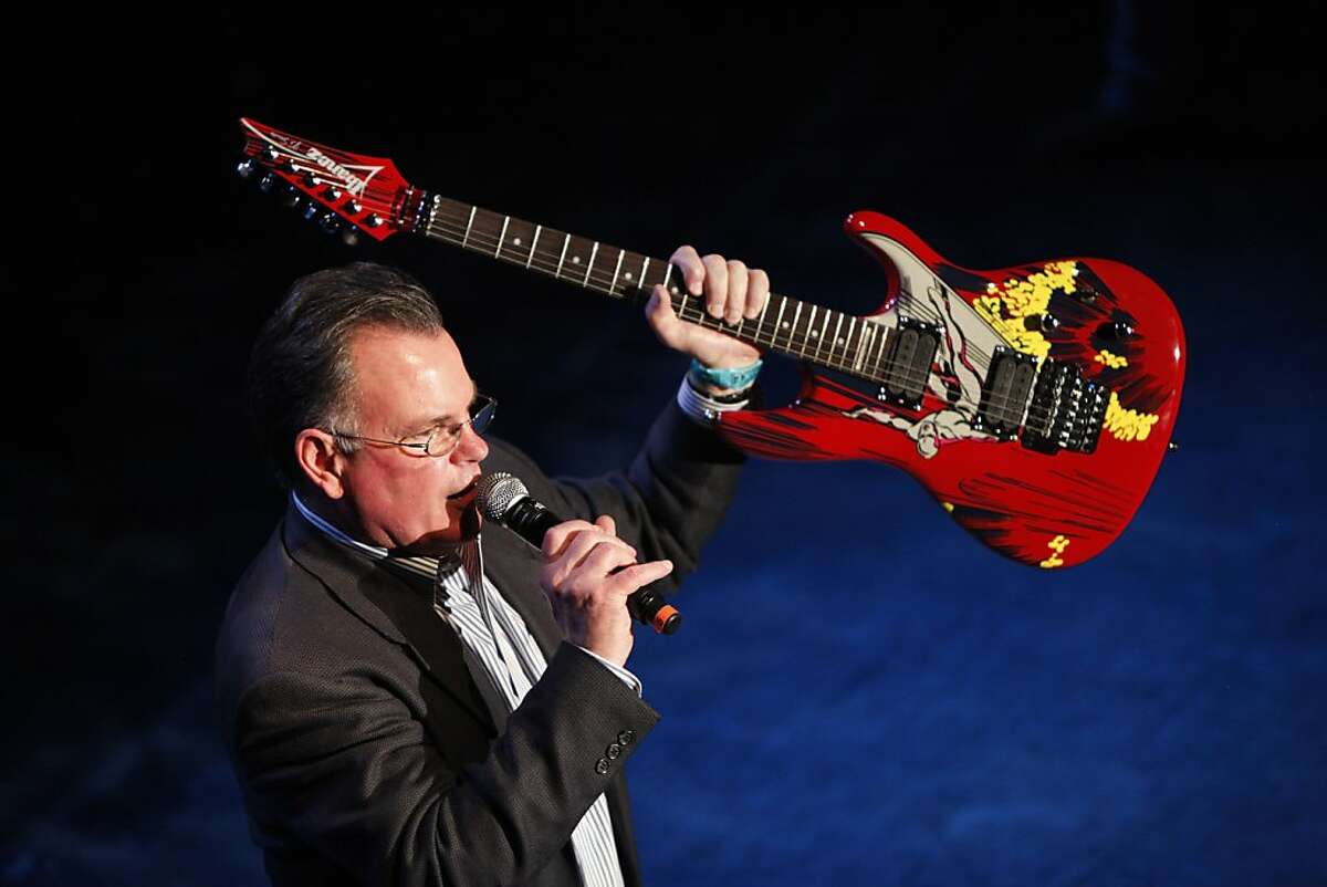 Steve Haworth auctions off a guitar for charity at the Ronnie Montrose Tribute Concert in San Francisco, Calif., on Friday, April 27, 2012.