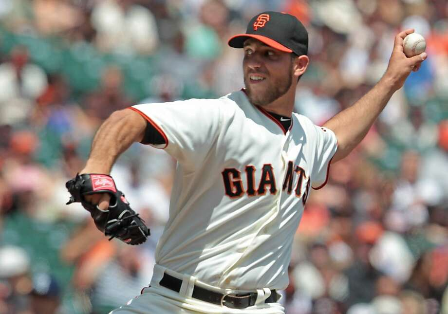 Giants' pitcher Madison Bumgarner delivers a pitch against the Padres at AT&T Park on Sunday, April 29, 2012, in San Francisco. Photo: Mathew Sumner, Special To The Chronicle