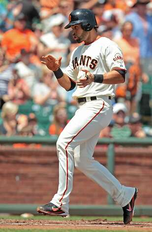 The Giants' Angel Pagan scores a run in the first inning against the Padres at AT&T Park on Sunday, April 29, 2012, in San Francisco. The Giants' won 4-1. Photo: Mathew Sumner, Special To The Chronicle