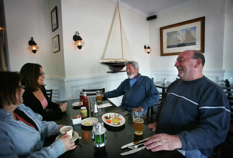 From left; Joanne Bauby, Patty Dinan, Joe Dinan, and Phil Roberts, all of Oxford, enjoy lunch at the Black Rock Yacht and Athletic Club at 3074 Fairfield Avenue in the Black Rock section of Bridgeport on Sunday, April 29, 2012. Photo: Brian A. Pounds / Connecticut Post