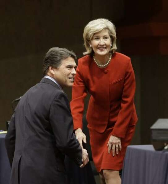 Texas Gov. Rick Perry and U.S. Sen. Kay Bailey Hutchison smile after greeting each other at the Murc