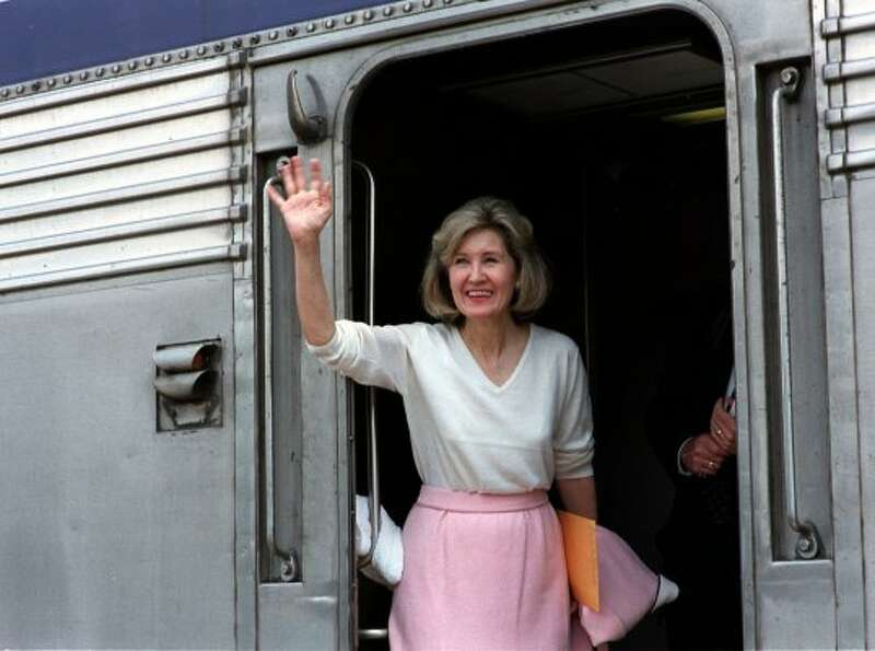 Sen. Kay Bailey Hutchison waves from an Amtrak car bound for Fort Worth on Sunday May 21, 2000, in A