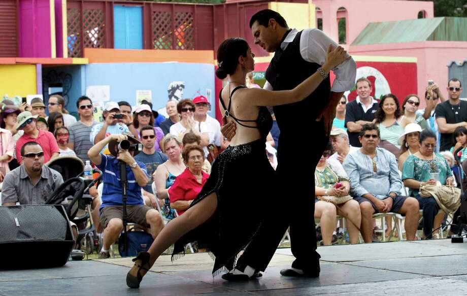 Mauro Marcone and Elizabeth Wingfield, with the Argentine Tango Club, perform on the HEB Cultural Stage during the Houston International Festival Sunday, April 29, 2012, in Houston. Photo: Brett Coomer, Houston Chronicle / © 2012 Houston Chronicle