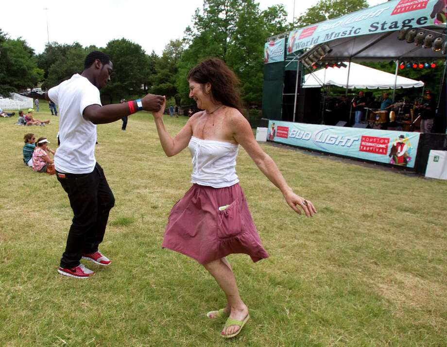 Joshua Tibbs, left, and Karen Hatch dance to the music of Sur at the Bud Light Worlds Music Stage during the Houston International Festival Sunday, April 29, 2012, in Houston. Photo: Brett Coomer, Houston Chronicle / © 2012 Houston Chronicle