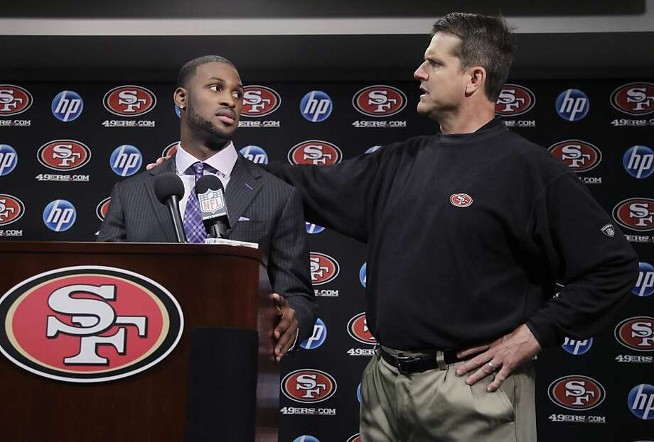 San Francisco 49ers first round draft pick  A.J. Jenkins, left, a wide receiver from Illinois, and head coach Jim Harbaugh, right, look at each other during an NFL football news conference at the team's headquarters in Santa Clara, Calif., Friday, April 27, 2012. (AP Photo/Paul Sakuma) Photo: Paul Sakuma, Associated Press