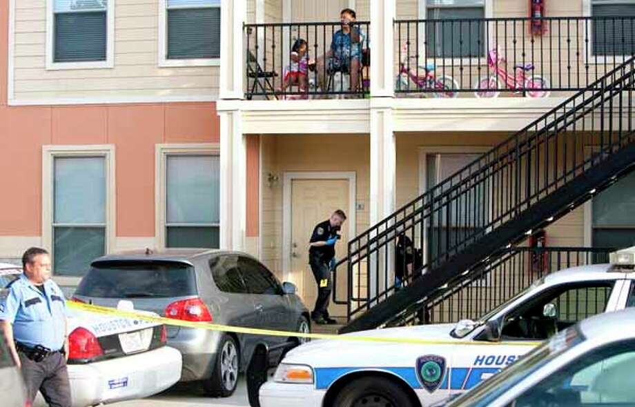 Police investigate the shooting of an 11-year-old boy at an apartment complex in the 2000 block of Laverne Street  Sunday, April 29, 2012, in Houston. Cody Duty / Houston Chronicle) Photo: Cody Duty, Houston Chronicle / © 2011 Houston Chronicle