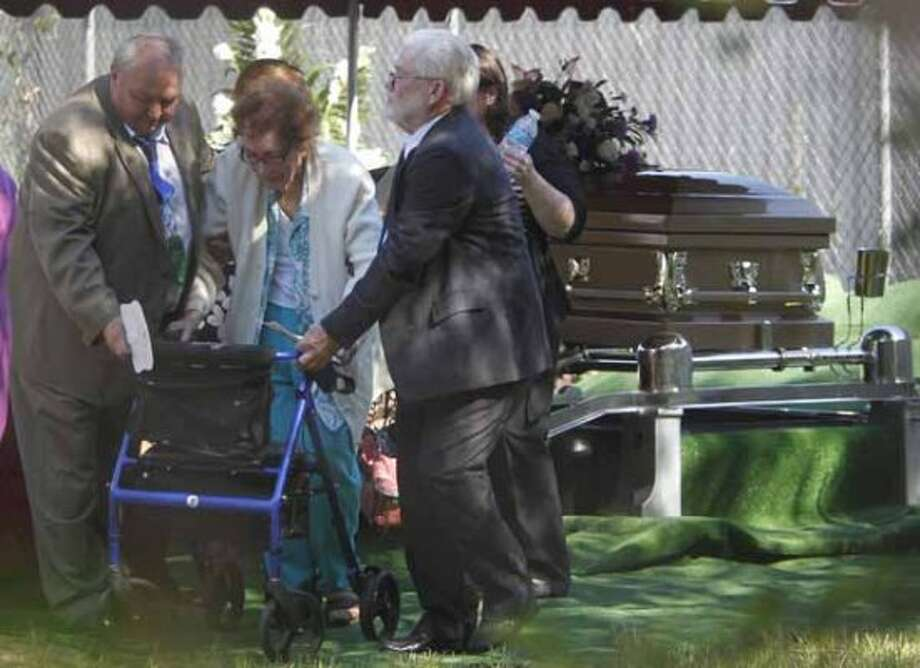 Family leaves after the interment ceremony for Kala Marie Golden-Schuchardt at Mt. Zion Cemetery on Tuesday, April 24, 2012, in The Woodlands.  Kala Marie Golden-Schuchardt, age 28 of Spring, Texas passed away on Tuesday, April 17, 2012 in The Woodlands. Verna McClain is accused of shooting Kala Golden-Schuchardt to death as she was leaving the Northwoods Pediatric Center, and kidnapping Keegan Schuchardt.  ( Mayra Beltran / Houston Chronicle ) (Houston Chronicle)