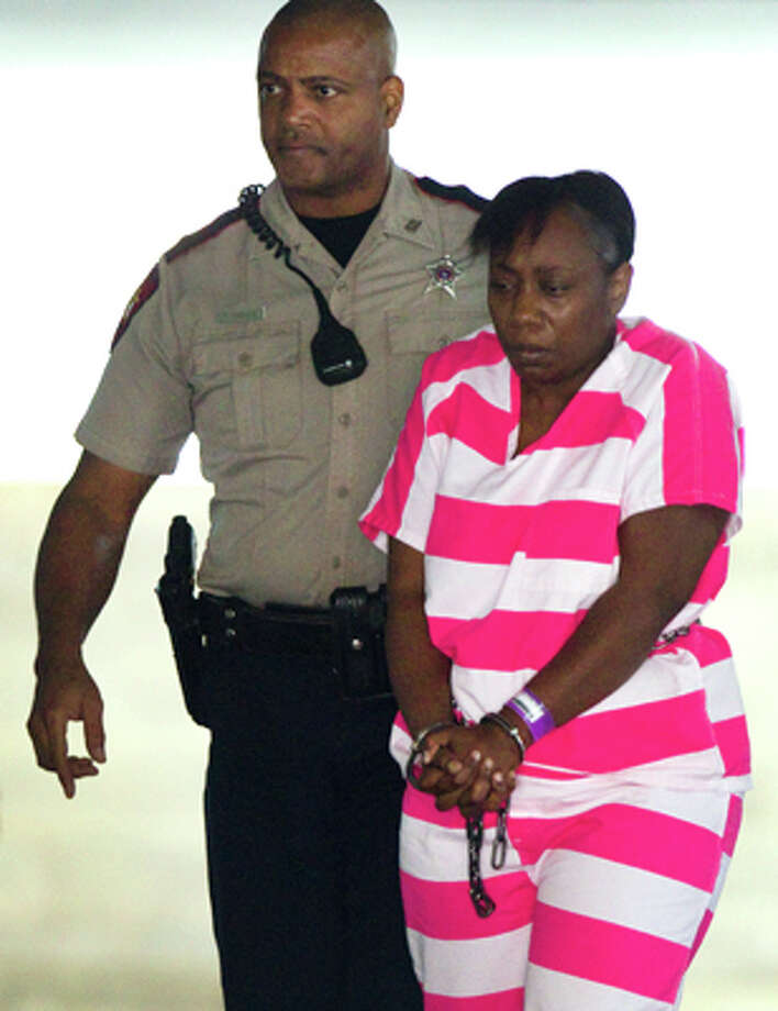 Verna McClain is escorted from the Montgomery County Courthouse following a bond hearing Monday, April 23, 2012, in Conroe. McClain, 30, was denied bond in connection with the shooting death of Kala Golden Schuchardt. Authorities say McClain shot and killed Schuchardt last Tuesday in the parking lot of Northwoods Pediatric Center in Spring, before placing the woman's newborn, Keegan Schuchardt, in her car and speeding off.   (Brett Coomer  / Houston Chronicle)