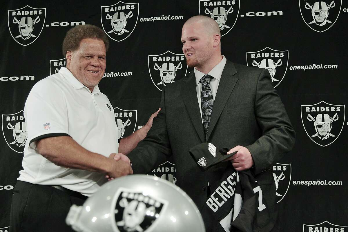 Oakland Raiders third-round NFL football draft pick Tony Bergstrom, right, shakes hands with general manager Reggie McKenzie during a news conference at the team's headquarters in Alameda, Calif., Saturday, April 28, 2012. (AP Photo/Paul Sakuma)