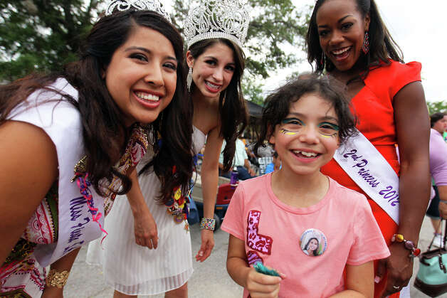 Carissa Rabago, 9 (center), poses for a photo with Miss Fiesta First Princess Miranda Gonzaba (from left), Miss Fiesta Katie Rivera and Miss Fiesta Second Princess Selina Affram after receiving the queen's pin during MissionFest at Mission San José, Sunday, April 29, 2012. Photo: JENNIFER WHITNEY, For The Express-News / special to the Express-News