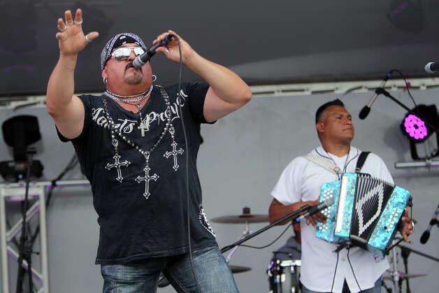"Phillip ""Big Flea"" Ramirez performs with his band Loz Fleaz during MissionFest at Mission San José, Sunday, April 29, 2012. Photo: JENNIFER WHITNEY, For The Express-News / special to the Express-News"