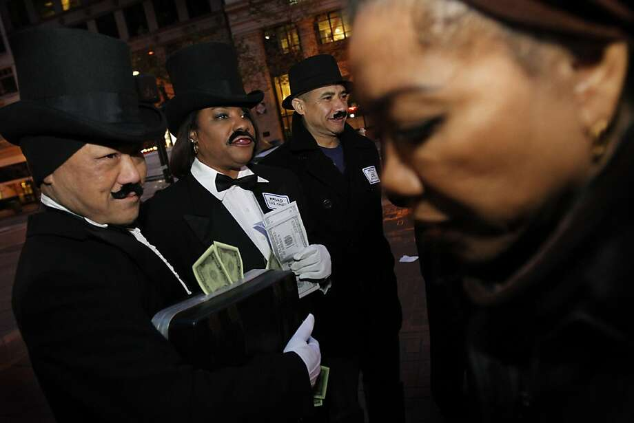Members of the SEIU local 1021, from left, Norm Ten, Karen Joubert, and David Camham dressed as the Monopoly man and handed out flyers to morning commuters to protest the city's tax breaks for big businesses Thursday morning in San Francisco, Calif., Thursday, April 5, 2012. Photo: Sarah Rice, Special To The Chronicle