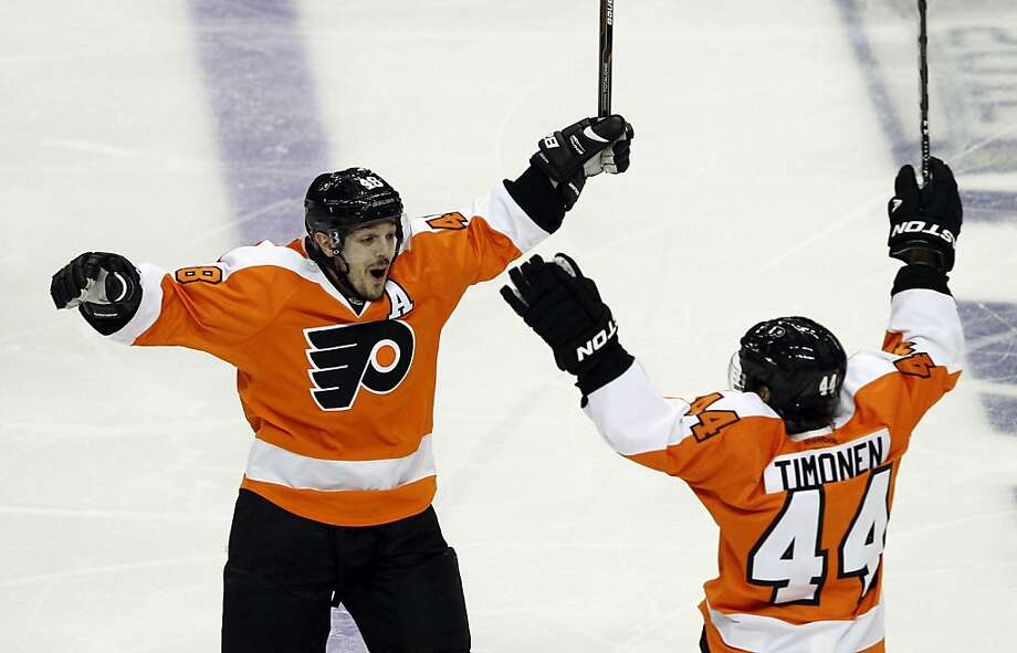 Philadelphia Flyers center Danny Briere (48) reacts with Kimmo Timonen (44), from Finland, after Briere scored the winning goal in the overtime period of Game 1 in a second-round NHL Stanley Cup hockey playoff series with the New Jersey Devils, Sunday, April 29, 2012, in Philadelphia. The Flyers won 4-3 in overtime. (AP Photo/Alex Brandon) Photo: Alex Brandon, Associated Press