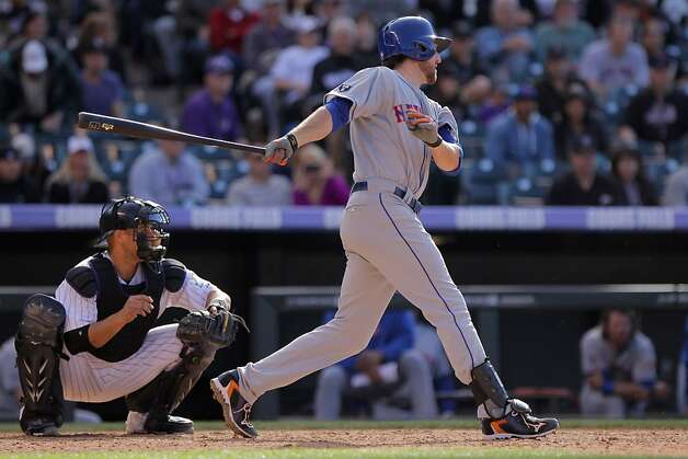 DENVER, CO - APRIL 29:  Ike Davis #29 of the New York Mets hits the game winning RBI single off of Matt Belisle #34 of the Colorado Rockies to score David Wright #5 of the New York Mets in the 11th inning at Coors Field on April 29, 2012 in Denver, Colorado. The Mets defeated the Rockies 6-5 in 11 innings.  (Photo by Doug Pensinger/Getty Images) Photo: Doug Pensinger, Getty Images