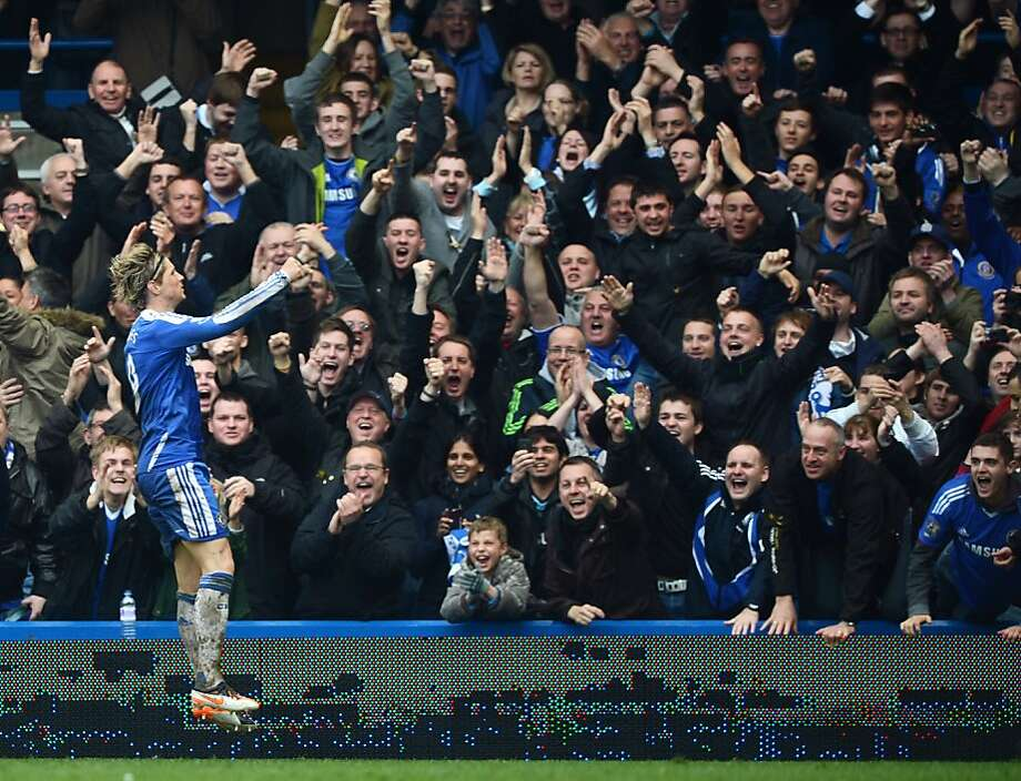"Chelsea's Spanish forward Fernando Torres (L) jumps to celebrate scoring his hat trick in front of the home fans during the English Premier League football match between Chelsea and QPR at Stamford Bridge in London on April 29, 2012. Chelsea's Fernando Torres scored a hat-trick in the match and Chelsea won the game 6-1. AFP PHOTO / ADRIAN DENNIS  RESTRICTED TO EDITORIAL USE. No use with unauthorized audio, video, data, fixture lists, club/league logos or ""live"" services. Online in-match use limited to 45 images, no video emulation. No use in betting, games or single club/league/player publications.ADRIAN DENNIS/AFP/GettyImages Photo: Adrian Dennis, AFP/Getty Images"