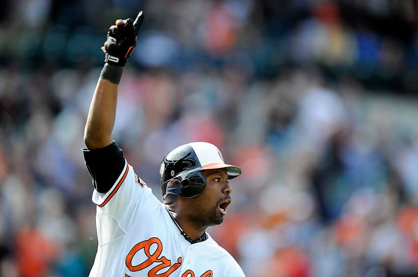 BALTIMORE, MD - APRIL 29: Wilson Betemit #24 of the Baltimore Orioles celebrates after hitting the game-winning home run in the ninth inning against the Oakland Athletics at Oriole Park at Camden Yards on April 29, 2012 in Baltimore, Maryland. Baltimore won the game 5-2. (Photo by Greg Fiume/Getty Images) *** BESTPIX ***