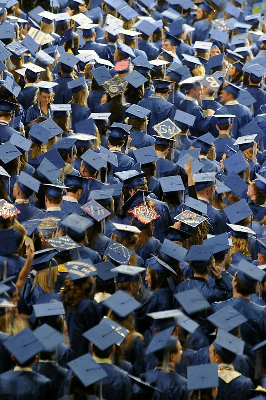 Grand Valley State University graduates partake in 2012 Commencement exercises at the Van Andel Arena on Saturday, April 28, 2012. (AP Photo/The Grand Rapids Press, Matt Gade)