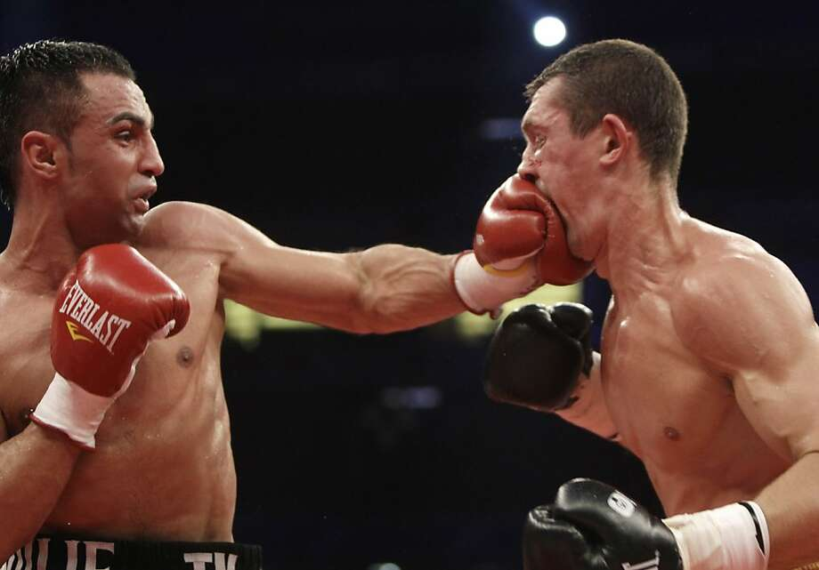 WBA world champion Vyacheslav Senchenko, right, of Ukraine receives a punch from challenger Paul Malignaggi of USA during their WBA World welterweight title fight in Donetsk, Ukraine, Sunday, April 29, 2012.   Paul Malignaggi won the fight and title.(AP Photo/Efrem Lukatsky) Photo: Efrem Lukatsky, Associated Press