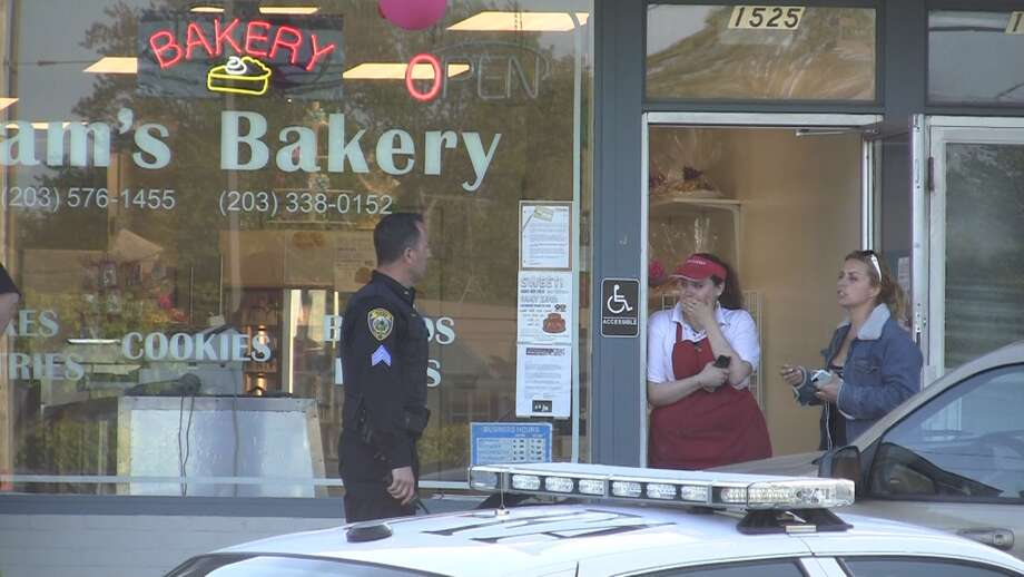 Fairfield, Conn. police investigate a report of an armed robbery the evening of Sunday, April 29, 2012 at Adams Bakery. Photo: Stephen Krauchick
