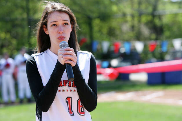Rebecca Pierpont, 18, sings the National Anthem at the Fairfield American Little League's opening day ceremonies at Gould Manor Park in Fairfield, Conn. on Sunday, April 29, 2012. Photo: B.K. Angeletti / Connecticut Post