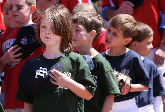 Ray, Jason Magoon, 6,  puts his cap to his heart during the National Anthem at the Fairfield American Little League's opening day ceremonies at Gould Manor Park in Fairfield, Conn. on Sunday, April 29, 2012. Photo: B.K. Angeletti / Connecticut Post