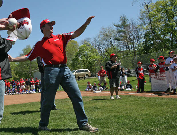 Dave Pierpont throws a pitch at the Fairfield American Little League's opening day ceremonies at Gould Manor Park in Fairfield, Conn. on Sunday, April 29, 2012. Photo: B.K. Angeletti / Connecticut Post