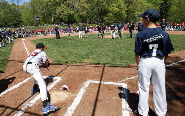 Biagio Paoletta, 12, left, catches a pitch from Harry Fiske at the Fairfield American Little League's opening day ceremonies at Gould Manor Park in Fairfield, Conn. on Sunday, April 29, 2012. Photo: B.K. Angeletti / Connecticut Post