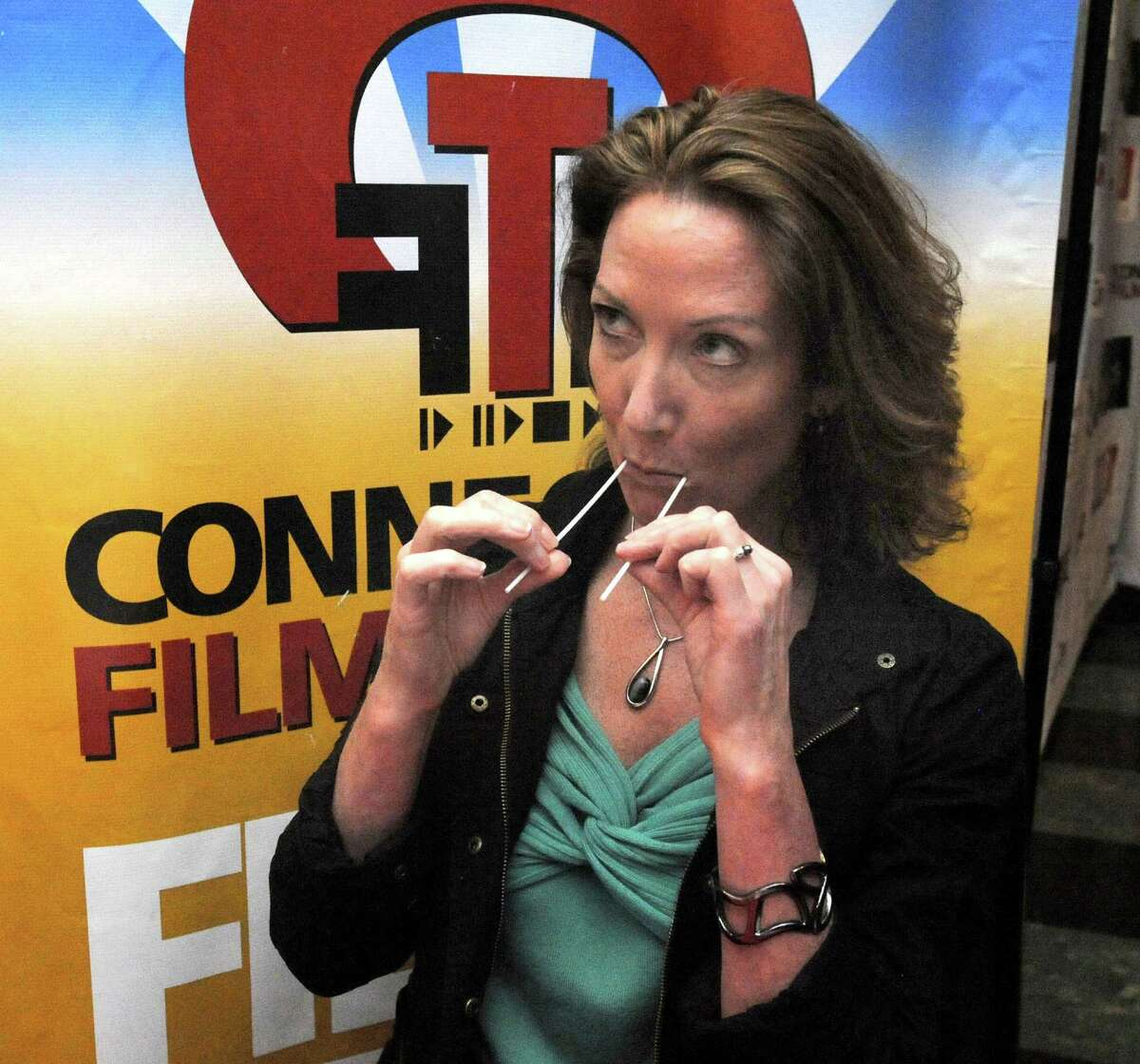 Susan Gross of Danbury swabs her mouth to become part of a bone marrow donor list at the Palace Theatre in Danbury during the Connecticut Film Festival Sunday, April 29, 2012. The closing movie,