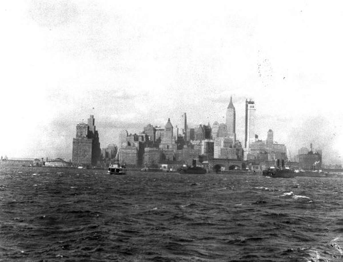FILE - This Nov. 7, 1930, file photo shows New York's skyline from the harbor. The Governor's Island Ferry is at right. (Associatd Press)