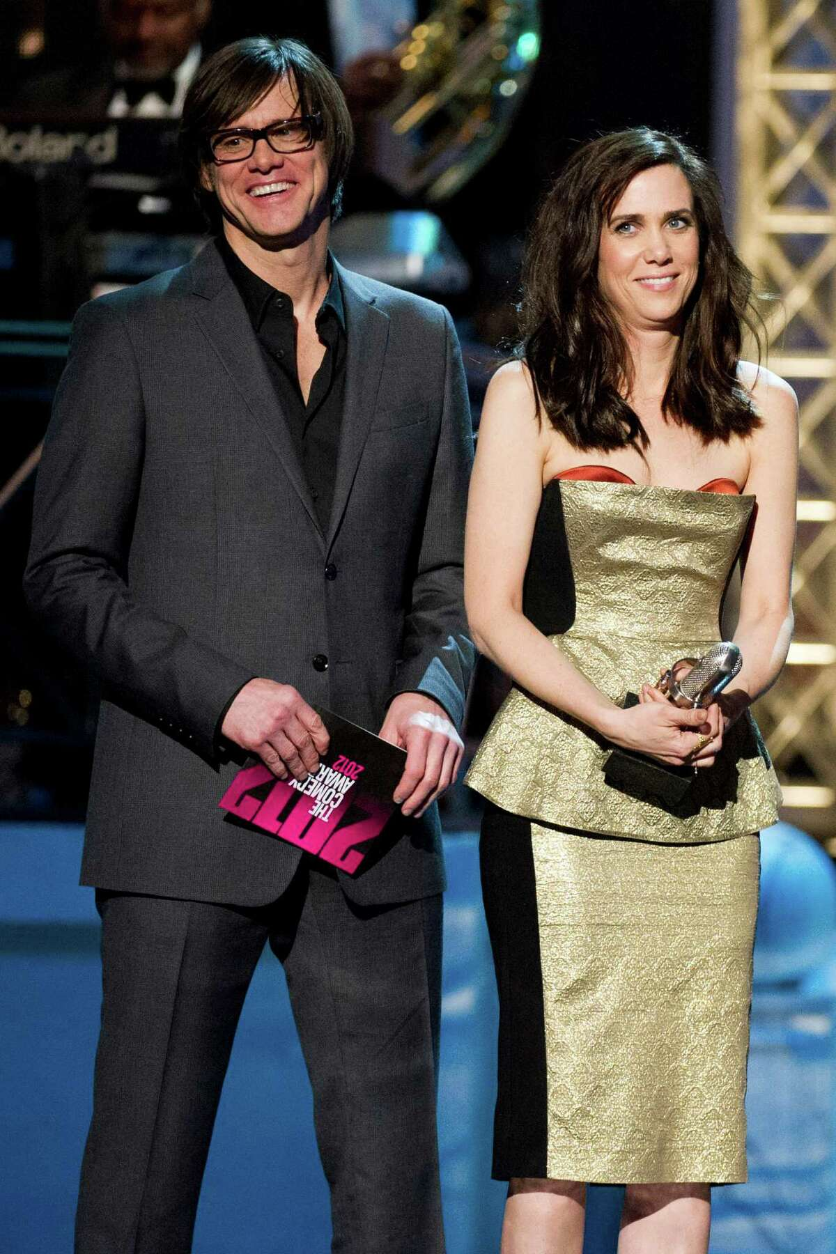 Jim Carrey and Kristen Wiig appear onstage at The 2012 Comedy Awards in New York, Saturday, April 28, 2012.