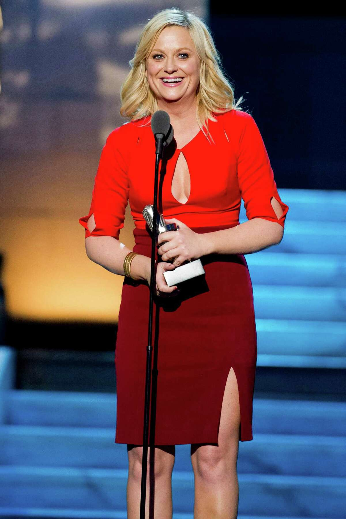 Amy Poehler accepts the best actress award at The 2012 Comedy Awards in New York, Saturday, April 28, 2012.