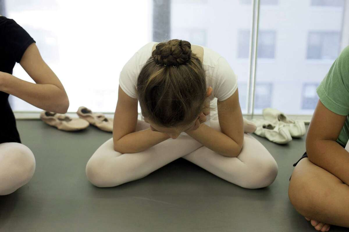 NEW YORK, NY - APRIL 27: A young girl waits to audition during tryouts for the School of American Ballet April 27, 2012 in New York City. The prestigious school has trained the majority of New York City Ballet's dancers as well as hundreds of dancers for other major ballet companies around the world.