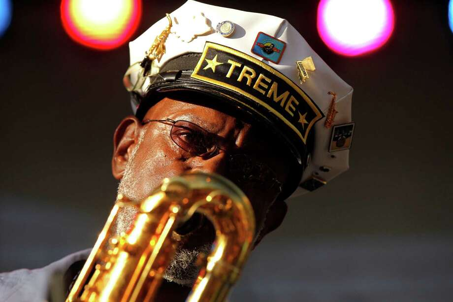 Roger Lewis with the Treme Brass Band perform at a sunrise concert marking International Jazz Day in New Orleans, Monday, April 30, 2012. The performance, at Congo Square near the French Quarter, is one of two in the United States that day; the other is in the evening in New York. Thousands of people across the globe are expected to participate in International Jazz Day, including events in Belgium, France, Brazil, Algeria and Russia. (AP Photo/Gerald Herbert) Photo: Gerald Herbert, Associated Press / AP