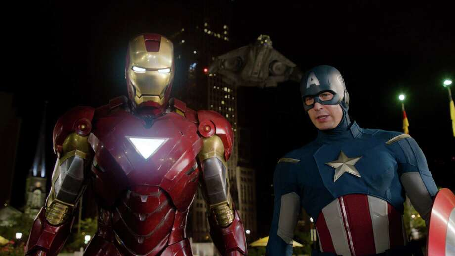 "In this film image released by Disney, Iron Man, portrayed by Robert Downey Jr., left, and Captain America, portrayed by Chris Evans, are shown in a scene from ""The Avengers"" (AP Photo/Disney) Photo: HONS / Disney"