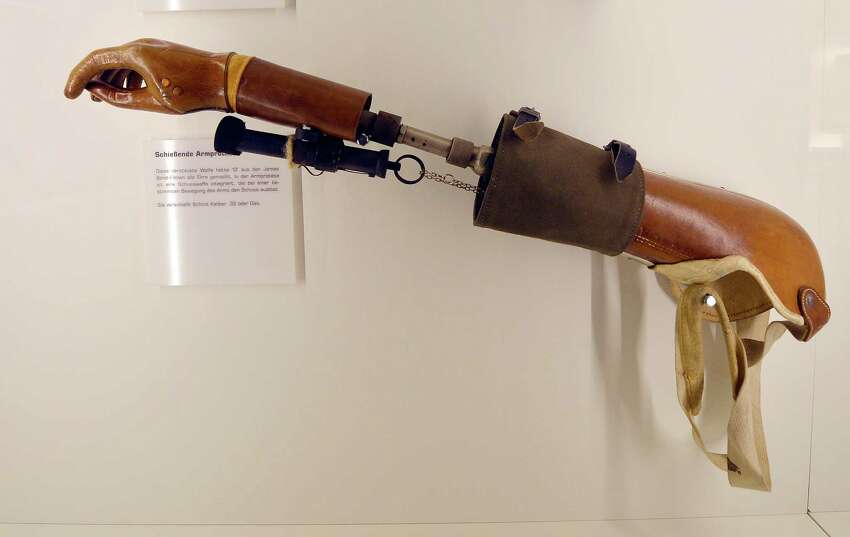 An arm prosthesis with a gun is on display at the spy museum in Oberhausen, Germany, in 2012.