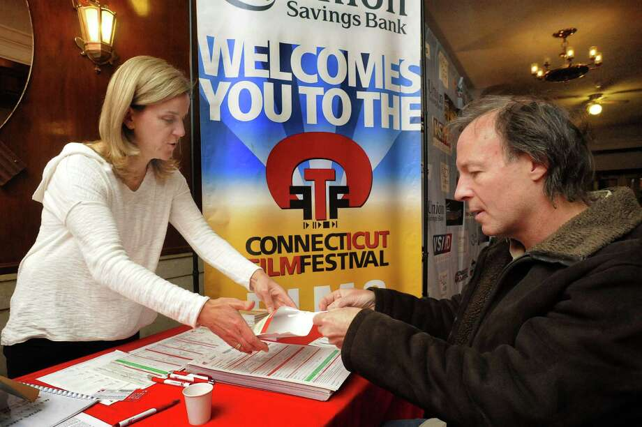 "Volunteer Dot Voorhees offers swabs to musician Bill Evans, from Miles Davis' group, to become part of a bone marrow donor list at the Palace Theatre in Danbury during the Connecticut Film Festival Sunday, April 29, 2012. The closing movie, ""More to Live For,"" is about three people looking for bone marrow donors to cure their leukemia. Photo: Michael Duffy"