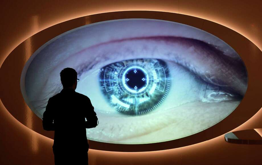 "A man watches a screen that shows an eye being scanned at the new spy museum in Oberhausen, Germany, Monday, April 30, 2012. The exhibition ""Top Secret"" explains the work of secret services and shows unique original details from the Russian KGB, the CIA and the east German STASI during the cold war. (AP Photo/Martin Meissner) Photo: Martin Meissner, Associated Press / AP"