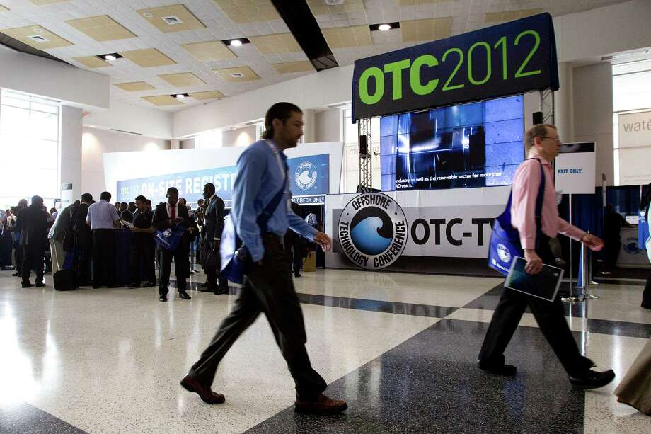 Attendees to the 2012 Offshore Technology Conference arrive the Reliant Center Monday, April 30, 2012, in Houston. Photo: Brett Coomer, Houston Chronicle / © 2012 Houston Chronicle