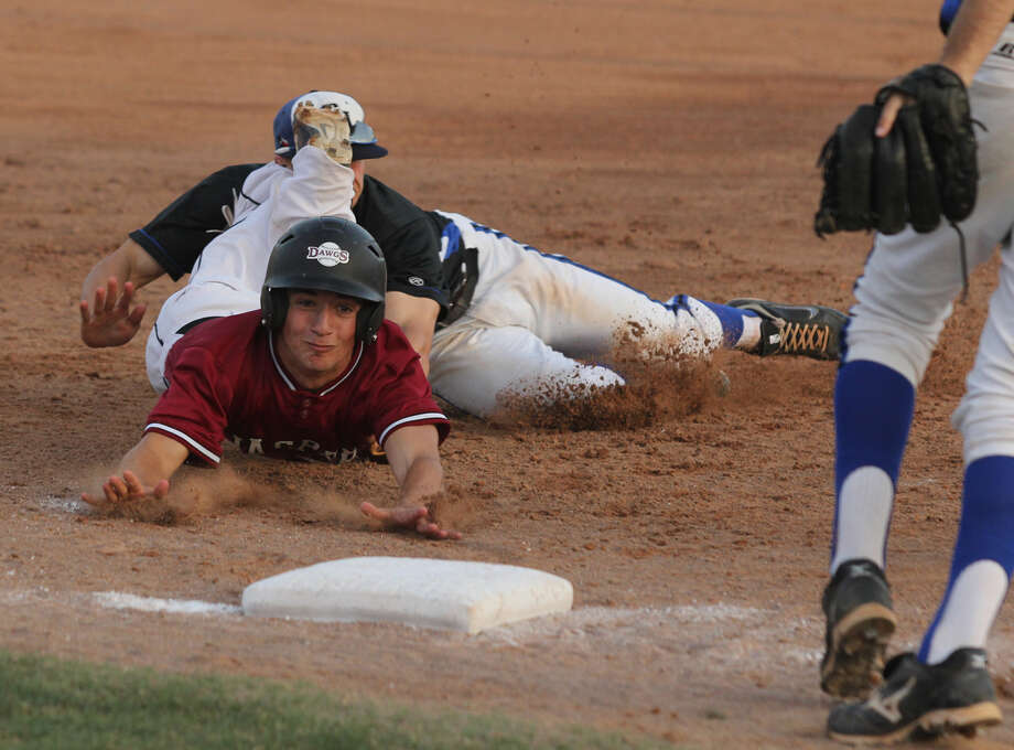 Colby DeCordova is tagged out during a rundown against Central Heights. Photo: Jason Dunn