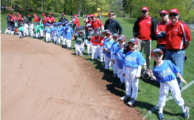 Fairfield American Little League teams line up along the infield at one of two newly renovatedl fields at Gould Manor Park for Sunday's dedication ceremonies. Photo: Mike Lauterborn / Fairfield Citizen contributed