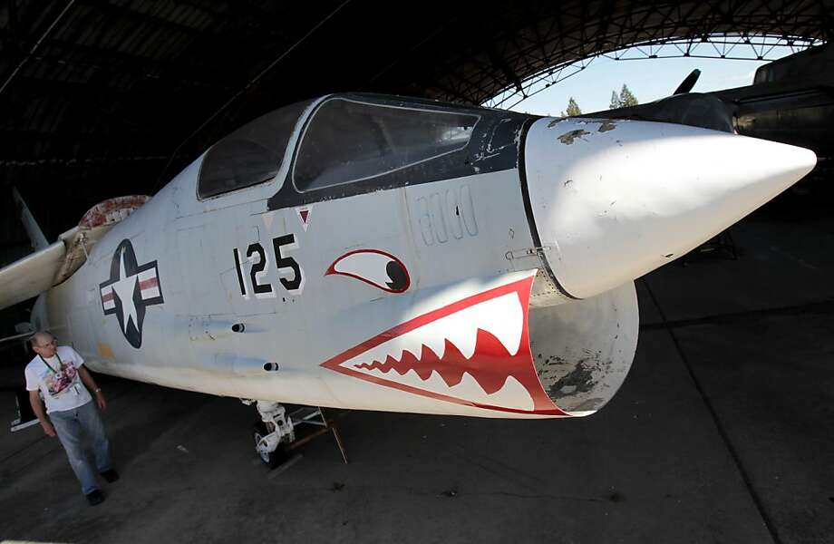 The F-8 Crusader war plane has been moved to a hangar to undergo a second restoration by the Pacific Coast Air Museum. Photo: Brant Ward, The Chronicle