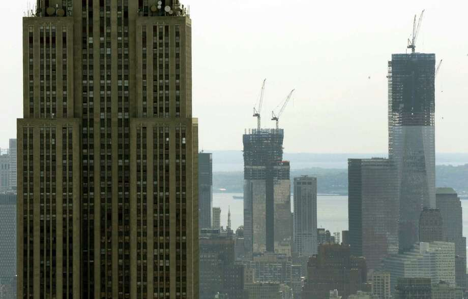 A view of the Empire State Building and One World Trade Center  (R) from the Top of the Rock Observation Deck at Rockefeller Center April 30, 2012. The Port Authority of New York and New Jersey held at a  press conference today to mark  the milestone of One World Trade Center becoming the tallest building in New York.  AFP PHOTO  TIMOTHY A. CLARYTIMOTHY A. CLARY/AFP/GettyImages Photo: TIMOTHY A. CLARY / AFP