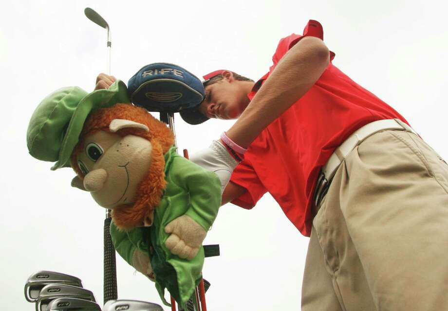 Buddy Hallman, of Fort Bend Travis, hopes he has the luck of the Irish with his leprechaun club cover as he warms up for the first round of the Class 5A state golf tournament at Onion Creek Golf Course on Monday, April 30, 2012 in Austin, Texas. Photo: J. Patric Schneider, For The Chronicle / Houston Chronicle