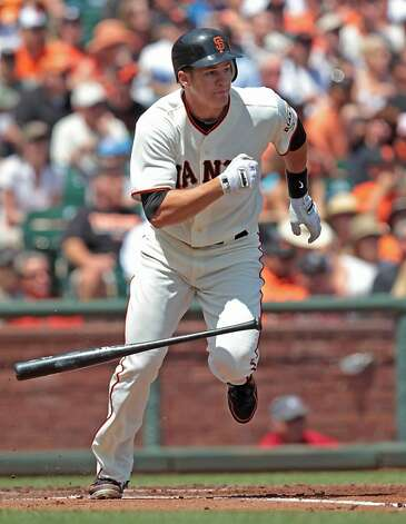 Giants' batter Brett Pill hits a single in the seventh  during a game against the Padres at AT&T Park on Sunday, April 29, 2012, in San Francisco. Pill went on to score on a Joaquin Arias triple. Photo: Mathew Sumner, Special To The Chronicle