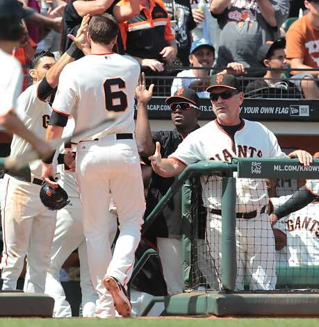 The Giants' Brett Pill is congratulated by manager Bruce Bochy after scoring on a Joaquin Arias triple against the Padres at AT&T Park on Sunday, April 29, 2012, in San Francisco. The Giants' won 4-1. Photo: Mathew Sumner, Special To The Chronicle